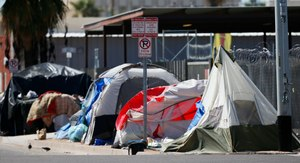 Tents and crude lean-tos crowd the sidewalks where many homeless people live along the streets in record numbers, as concerns grow over the homeless population due to the coronavirus Tuesday, March 24, 2020, in Phoenix. Image: AP Photo/Ross D. Franklin