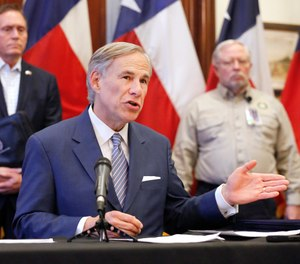 Texas Governor Greg Abbott discusses the state's coronavirus response during a press conference in Austin on March 29, 2020. (Tom Fox/The Dallas Morning News via AP, Pool)