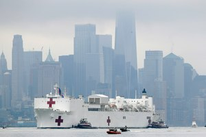 The Navy hospital ship USNS Comfort passes lower Manhattan on its way to docking in New York, Monday, March 30, 2020. Image: AP Photo/Seth Wenig
