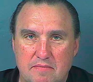 This Monday, March 30, 2020, booking photo provided by the Hernando County Jail shows Rodney Howard-Browne, pastor of The River Church. (Hernando County Jail via AP)