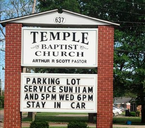 This image provided by Alliance Defending Freedom shows the sign for parking lot church services outside of Temple Baptist Church in Greenville, Miss., on April 9, 2020. (Alliance Defending Freedom via AP)