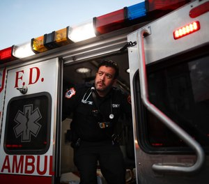 FDNY Paramedic Alex Tull, who has recently recovered from COVID-19, prepares to begin his shift outside EMS station 26 in the Bronx.