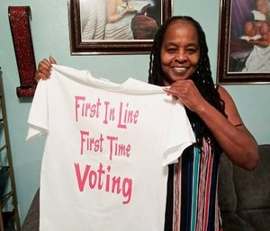 Betty Riddle in Sarasota, Fla., holds the T-shirt she wore on March 17, 2020, when she voted for the first time. (Photo courtesy of Rickie Riddle via AP)