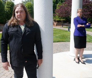 Halifax County Commonwealth's Attorney Tracy Martin, right, poses with Kevin Wynn at the Halifax County War Memorial on May 6, 2020, in Halifax, Va. (AP Photo/Steve Helber)