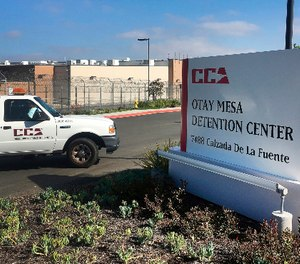 A vehicle drives into the Otay Mesa Detention Center in San Diego. (AP Photo/Elliot Spagat)