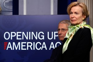 Dr. Anthony Fauci, director of the National Institute of Allergy and Infectious Diseases, and Dr. Deborah Birx, White House coronavirus response coordinator, listen during a briefing about the coronavirus in the James Brady Press Briefing Room of the White House in Washington. Image: AP Photo/Alex Brandon