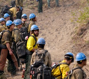 Newly released national plans for fighting wildfires during the coronavirus pandemic are hundreds of pages long but don't offer many details on how fire managers will get access to COVID-19 tests or exactly who will decide when a crew needs to enter quarantine. (AP Photo/Elaine Thompson,File)