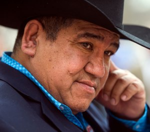 In this Feb. 28, 2017, file photo, Chairman Harold Frazier of the Cheyenne River Sioux Tribe leaves federal court in Washington. (AP Photo/Cliff Owen File)