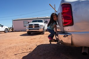 In this April 22, 2020, photo, a little girl plays in her family compound in Tuba City, Ariz. Even before the pandemic, people living in rural communities and on reservations were among the toughest groups to count in the 2020 census. Image: AP Photo/Carolyn Kaster