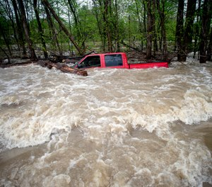 Tittabawassee Fire and Rescue rescued the driver from this red pickup truck in Saginaw County, Mich. The truck was swept off of the road by standing water.