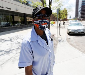 A resource published by the National Academies of Sciences, Engineering and Medicine offers strategies for promoting COVID-19-preventing behaviors, such encouraging people to wear face masks displaying the logo of their favorite sports team. (AP Photo/David Zalubowski)