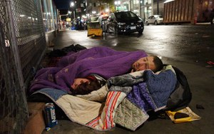 Two people sleep on a street in downtown Portland, Ore. Image: AP Photo/Ted S. Warren