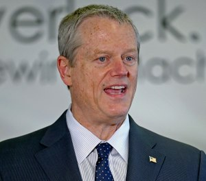 In this May 5, 2020, photo, Massachusetts Gov. Charlie Baker speaks during a news conference. (Stuart Cahill/Boston Herald via AP, Pool)
