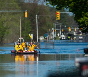 A search and rescue boat is deployed as floodwater rises in Midland, Mich., Wednesday, May 20, 2020. A Michigan EMT who survived COVID-19 lost his home during the historic floods after the Edenville Dam was breached. (Photo/Katy Kildee, Midland Daily News via AP)