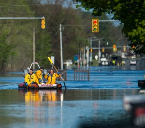 A search and rescue boat is deployed as floodwater rises in Midland, Mich., Wednesday, May 20, 2020. A Michigan EMT who survived COVID-19 lost his home during the historic floods after the Edenville Dam was breached.
