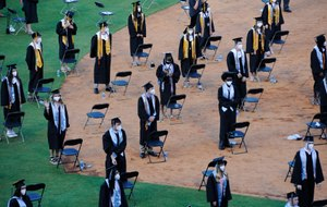 Seniors from Spain Park High School stand on a baseball field at a socially distanced graduation ceremony in Hoover, Ala., Wednesday, May 20, 2020. Health officials say usual graduation ceremonies could endanger the public health by promoting the spread of disease. But school officials say they're using social distancing guidelines and abiding by state health rules. Image: AP Photo/Jay Reeves