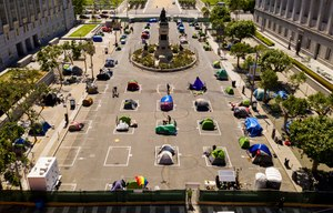 Rectangles designed to help prevent the spread of the coronavirus by encouraging social distancing line a city-sanctioned homeless encampment at San Francisco's Civic Center on Thursday, May 21, 2020. Image: AP Photo/Noah Berger