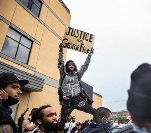 Protesters gather near the Minnesota Police 3rd Precinct Tuesday, May 26, 2020, in response to the death of George Floyd in police custody. (Richard Tsong-Taatarii/Star Tribune via AP)