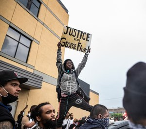 Protesters gather near the Minnesota Police 3rd Precinct Tuesday, May 26, 2020, in response to the death of George Floyd in police custody.