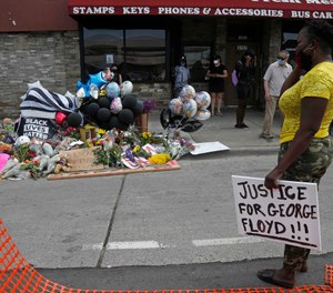 Protesters gather at a makeshift memorial in Minneapolis near the site where George Floyd was taken into police custody before he died. (AP Photo/Jim Mone)