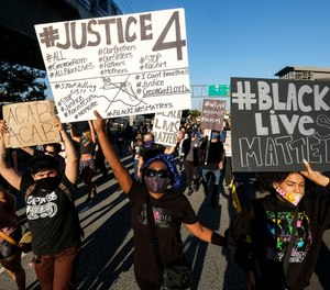 Demonstrators shut down the Hollywood Freeway in Los Angeles on Wednesday, May 27, 2020, during a protest about the death of George Floyd in police custody in Minneapolis earlier in the week.