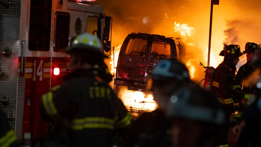 A vehicle burns near New York's Union Square, Saturday, May 30, 2020, during a demonstration against the death of George Floyd, a black man who died in Minneapolis police custody on May 25.