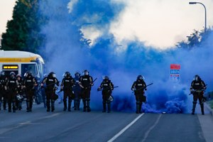 Police in riot gear prepare to advance on protesters, Saturday, May 30, 2020, in Minneapolis. Image: AP Photo/John Minchillo