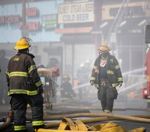 Firefighters battle a blaze in Philadelphia, Monday, June 1, 2020 in the aftermath of protest and unrest in reaction to the death of George Floyd. Floyd died after being restrained by Minneapolis police officers on May 25. (AP Photo/Matt Rourke)