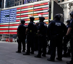 Police officers in protective gear stand by in Times Square during a protest in Manhattan in New York, Monday, June 1, 2020. (AP Photo/Seth Wenig)