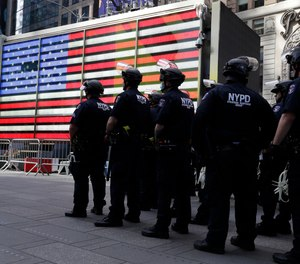 Police officers in protective gear stand by in Times Square during a protest in Manhattan in New York, Monday, June 1, 2020.