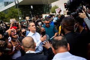 Los Angeles Mayor Eric Garcetti joins pastors and marchers outside LAPD Headquarters during a demonstration demanding justice for George Floyd, Tuesday, June 2, 2020. Image: Sarah Reingewirtz/The Orange County Register via AP