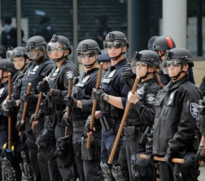 Across the country, officers honorably showed up for duty to ensure Americans could peaceably assemble. (AP Photo/Elaine Thompson)