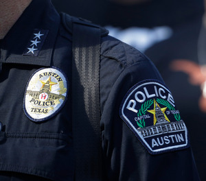 Members of the Austin police department march with members of the University of Texas football team to the State Capitol in Austin, on Thursday, June 4, 2020.