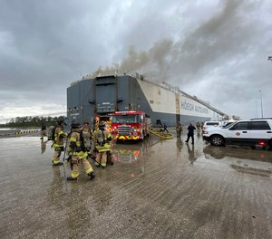 Florida firefighters respond to a fire after an explosion aboard a ship in 2020. First responders are among those discussed for $1,000 state bonus checks.