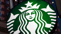 Starbucks worker charged after 'bragging' about spitting in cop's coffee, police chief says