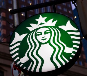 This June 26, 2019, file photo shows a Starbucks sign in downtown Pittsburgh. (AP Photo/Gene J. Puskar, File)
