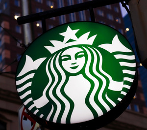 This June 26, 2019, file photo shows a Starbucks sign in downtown Pittsburgh.