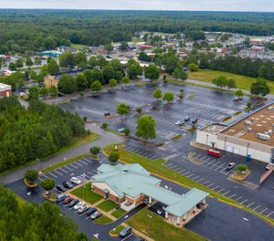 This aerial drone photo shows the Call Federal Credit Union building, front, Tuesday June 16, 2020, in Midlothian, Va. Police were able to obtain geofence search warrants, a tool being increasingly used by law enforcement. The warrant sought location histories kept by Google of cellphones and other devices used within 150 meters (500 feet) of the bank. (AP Photo/Steve Helber)