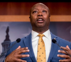 Sen. Tim Scott, R-S.C., accompanied by Republican senators speaks at a news conference to announce a Republican police reform bill on Capitol Hill in Washington.