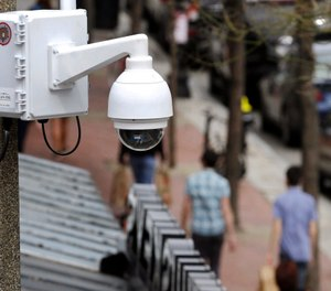 In this April 14, 2014, file photo, a surveillance camera is attached to a light pole along Boylston Street in Boston. (AP Photo/Steven Senne, File)