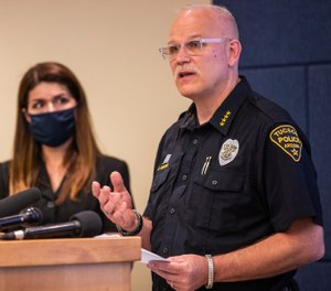 Tucson Police Chief Chris Magnus, right, speaks as Mayor Regina Romero listens during a press conference, Wednesday, June 24. (Josh Galemore/Arizona Daily Star via AP)