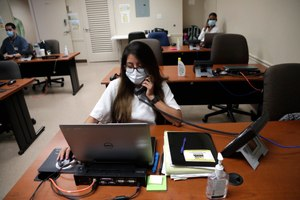 Maria Fernanda works on contact tracing at the Florida Department of Health in Miami-Dade County. Contact tracers are often met with reluctance, and sometimes anger, when attempting to do their jobs. Image: AP Photo/Lynne Sladky