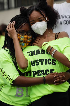 In this June 20, 2020, photo, Ke'Moriae Font, left, hugs Mihrell Reece while listening to a speaker during a youth-led demonstration in Los Angeles calling for an end to racial injustice and for police accountability. Image: AP Photo/Marcio Jose Sanchez