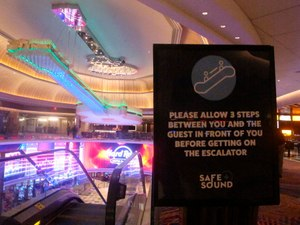 This June 24, 2020 photo shows a sign in the Hard Rock casino in Atlantic City N.J. instructing customers to maintain a distance on the escalator to prevent the spread of the coronavirus. Image: AP Photo/Wayne Parry