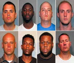 These photos provided by the Caddo Parish Sheriff's Office show, top row from left, police officers Aaron Jaudon, D'Andre Jackson, Mark Ordoyne and William Isenhour. Bottom row from left show police officers Christopher McConnell, Brandon Walker, Treveion Brooks and David Francis.