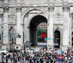 Protesters gather at an encampment outside City Hall, Tuesday, June 30, 2020, in New York. (AP Photo/John Minchillo)