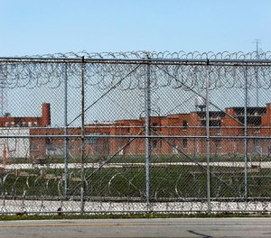 This April 20, 2020 file photo shows the Marion Correctional Institution in Marion, Ohio. The number of prison inmates testing positive for the coronavirus soared well past the 50,000 mark this week, as recent outbreaks threatened to undo control measures put in place earlier in the pandemic. (Fred Squillante/The Columbus Dispatch via AP, File)