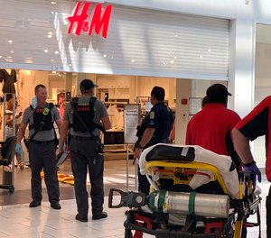 Authorities continue their investigation of a shooting at Riverchase Galleria shopping mall, Friday, July 3, 2020, in Hoover, Ala., that left an 8-year-old boy dead and three other people hospitalized.