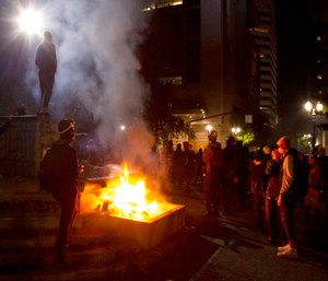 Portland police say more than 12 people were arrested after throwing fireworks and mortars as they clashed with police during the latest rally decrying police brutality. (Photo/Beth Nakamura of The Oregonian via AP)