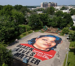 A ground mural depicting a portrait of Breonna Taylor is seen at Chambers Park, Monday, July 6, 2020, in Annapolis, Md. (AP Photo/Julio Cortez)